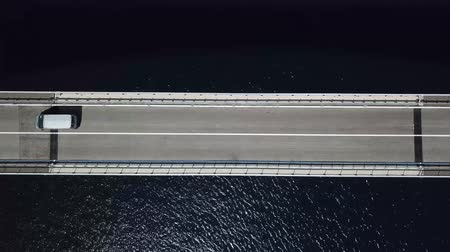 denteado : Aerial view of the island of Pag, Croatia, roads and Croatian coast. Cars crossing the bridge seen from above