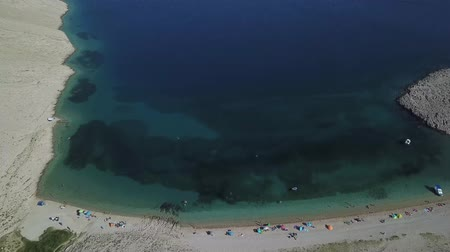 salt bed : Aerial view of Rucica beach on Pag island, Metajna, Croatia. Seen from above, bathers, relaxation and summer holidays. Promontories and cliffs of Croatian coasts