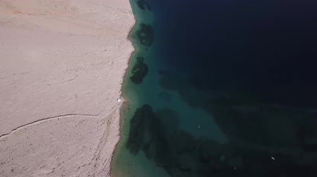 strandlaken : Aerial view of Rucica beach on Pag island, Metajna, Croatia. Seen from above, bathers, relaxation and summer holidays. Promontories and cliffs of Croatian coasts
