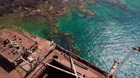 Aerial view of a ship in the Atlantic ocean. Details of the ship seen closely. Wreck of the Greek cargo ship: Telamon; near Arrecife in Lanzarote, Canary Islands, Spain.