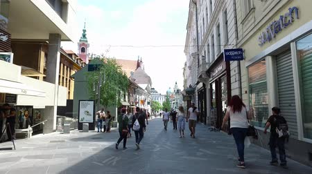 Central streets of the city of Ljubljana the capital and largest city of Slovenia. 06262018. People strolling in the pedestrian area of the city. Shops and buildings with unique architecture