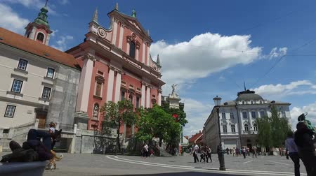 pré histórico : Central streets of the city of Ljubljana the capital and largest city of Slovenia. 06262018. People strolling in the pedestrian area of the city. Churches and castle on the hill.