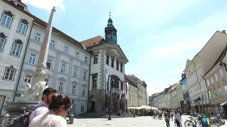pré histórico : Central streets of the city of Ljubljana the capital and largest city of Slovenia. 06262018. People strolling in the pedestrian area of the city. Churches and castle on the hill