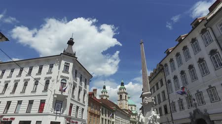 fővárosok : Central streets of the city of Ljubljana the capital and largest city of Slovenia. 06262018. People strolling in the pedestrian area of the city. Churches and castle on the hill.