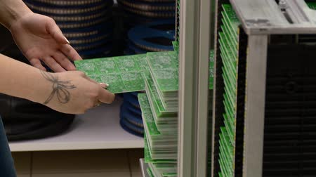 worker manually sorting circuit boards