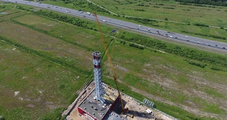 Chimney pipe construction. Aerial shot, fly around Stock Footage