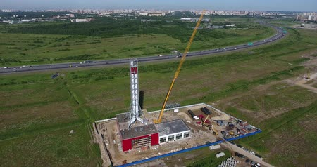 Construction site of gas power plant aerial flying forward