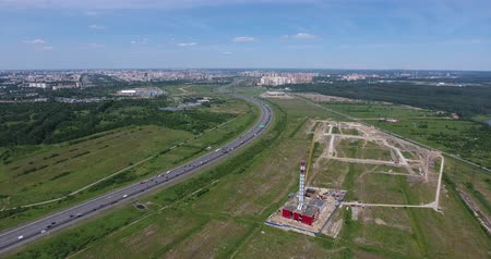 Construction site of gas power plant aerial and highway