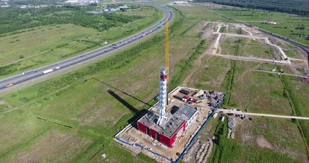 Construction site of gas power plant aerial, flying back Stock Footage