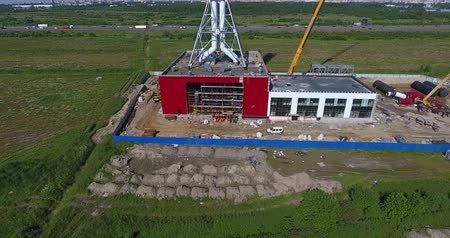 дымоход : Construction site of gas power plant aerial, construction vehicles Стоковые видеозаписи