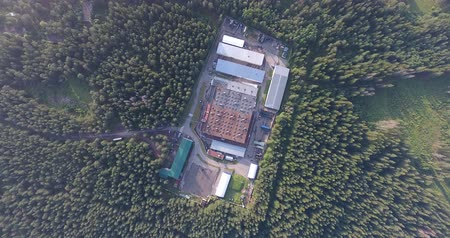 Modern factory building in the green forest aerial