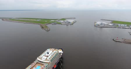 Aerial of cruise ship and Saint-Petersburg Flood Prevention Facility Complex