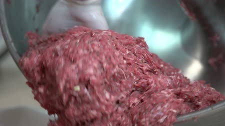 ground meat : Worker unloads mincemeat from mixer Stock Footage