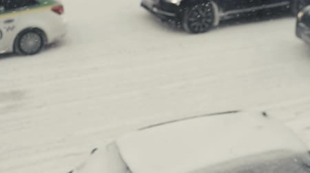 Winter snow, city traffic. Slow motion