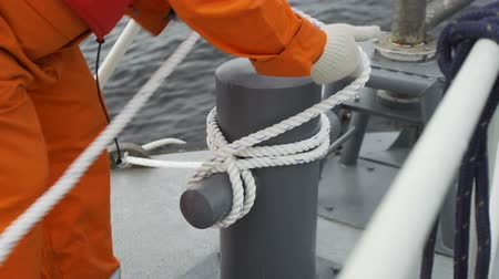 kotva : Sailors hands pulling ropes of anchor
