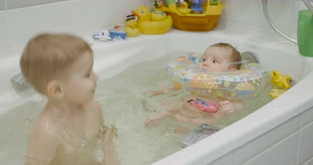 know : Two baby enjoying the water bath