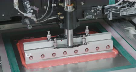 Machine causes the pink sealant on PCB. Closeup Dostupné videozáznamy