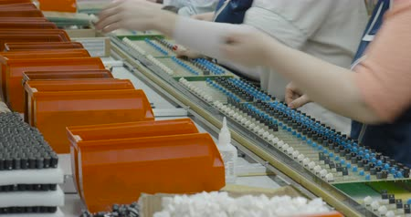 circuitry : Workers manually assemble Electronic parts on PCB Stock Footage
