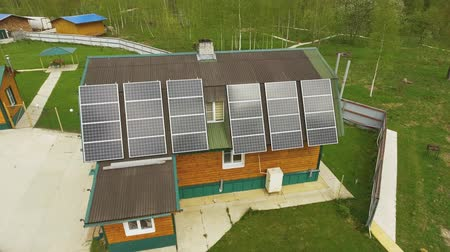 harness : Aerial view of eco-friendly house with solar panels karelian landscape on back Stock Footage