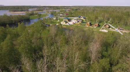 Észtország : Aerial view of the village and beautiful river in the Karelian forests Stock mozgókép