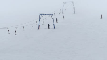 fogged : Surface lift lifts people to the top of the mountain. Stock Footage