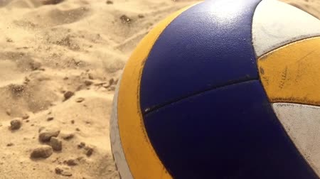 empty beach : Volleyball ball on the beach. Slow motion. Stock Footage