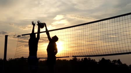 volleyball : Professional Beach Volleyball at Sunset in Slow Motion. Stock Footage