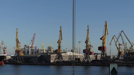industry : Unloading cargo ship in the port with large cranes. Stock Footage