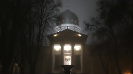 historical building : The illuminated Church at night. The foggy weather.