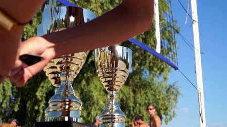 trofej : Three cups for the winners of the tournament.