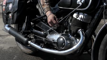 workshop : Hands Repairing the Engine of a Motorcycle. Shot Closeup. the Action in Real Time.