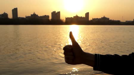 good : Hand Make Like at Sunset. Sea on the Background. Beautiful Action. Stock Footage