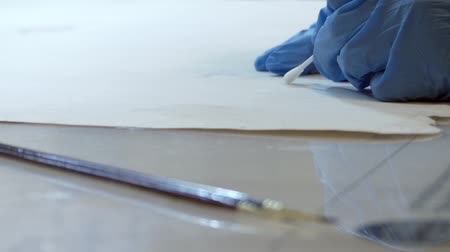 restorer : the Process of Restoration of Old Paintings in the Laboratory. the Action in Real Time.