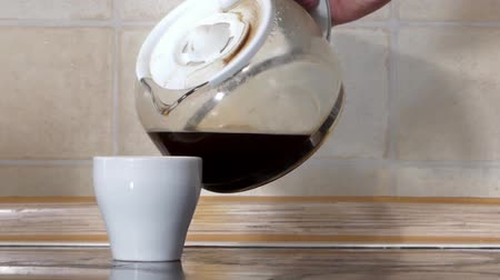 caffe : Coffee Maker Pours the Coffee. the Action in Real Time.