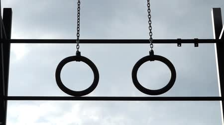 gimnastyka : Gymnastic Rings Hanging in the Air. Silhouette of Power.