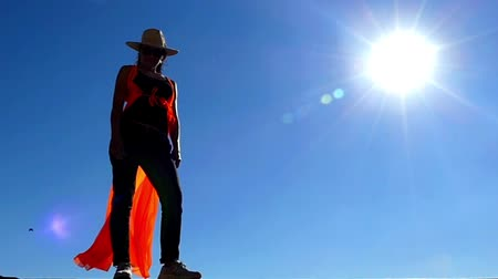 vida selvagem : Girl in Cowboy and Cloak Hat Stands in Sun Light on the Wind. the Action in Slow Motion. Vídeos