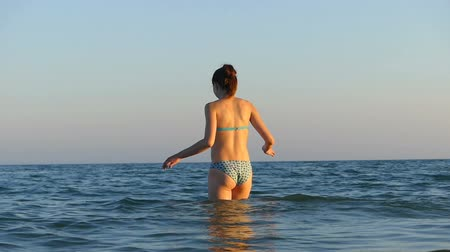delgado : Young woman goes to swim in the Black sea waters Stock Footage
