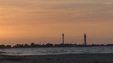 remendo : Fine seascape with a tower and a lighthouse in the background Stock Footage