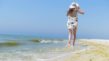 splendid : Slim woman in pareo and bikini runs along the Black Sea coast in slo-mo