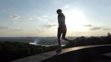 kiev : Blond man dances on an observation deck in Kyin in slo-mo Stock Footage