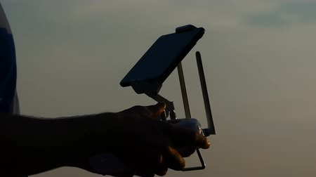 golden color : Male hands keep a panel screen to control the flight of a drone