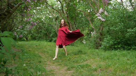 leylak : Young girl dancer in marsala dress is coming outdoors