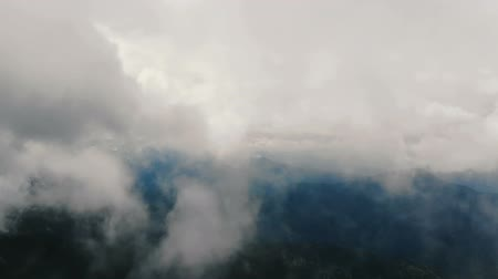 alpinism : Amazing clouds over mountains - aerial shot. Stock Footage