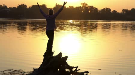 pop art background : Cheery man dances on a lake bank at a golden sunset