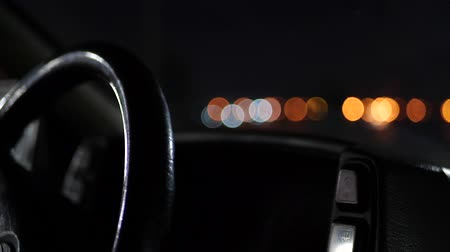 hız göstergesi : The steering wheel of the car in the light of night lights.