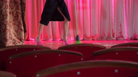 süpürge : Woman cleans the broom on the stage after the concert. Stok Video