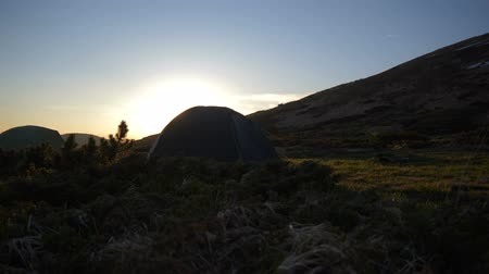 megőriz : Spherical dark tent installed on a mountain slope in the Carpathians in slo-mo
