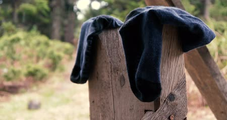 ruhacsipesz : Black socks are put on some wooden construction in the Carpathians in slo-mo Stock mozgókép