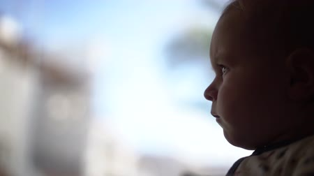 emmek : Serious little baby looks away in slow motion