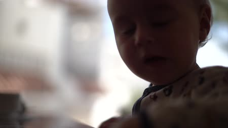 smutny : The baby negatively waving his head close up in slow motion
